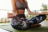 Woman Body In Yoga Pose Meditating poster