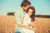 Young Couple In Love Outdoor.d.couple Hugging.young Beautiful Couple In Love Staying And Kissing On poster