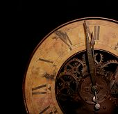 A photo of an old clock striking twelve