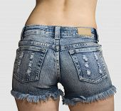 Girl In Blue Jeans Short Shorts Isolated