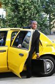 A business man getting out of a taxi cab poster