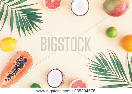 poster of Summer Tropical Composition. Green Palm Leaves And Tropical Fruits On Pastel Yellow Background. Summ