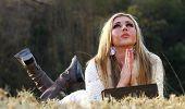 Blonde Lady Praying Lying On Her Stomach