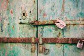 Постер, плакат: Locked Door Closed Old Rusty Padlocks On A Distressed Wooden Door