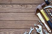 Varieties Handy Tools On Wooden Background. Hammer, Saw, Wrenches, Adjustable Wrench, Paint Brushes, poster