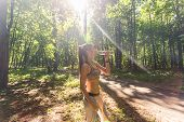 Fitness Beautiful Woman Drinking Water And Sweating After Exercising On Summer Hot Day In Park. Fema poster