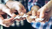 Close Up Hand Of Group Business Partnership People Puting Together A Jigsaw Puzzle  , Business Teamw poster