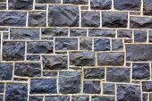 Blue hued rectangular shaped stone wall