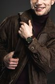 Outgoing Young Male Keeping Bag In Hands. He Wearing Modern Watch. Gladness And Fashion Concept poster