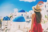 Tourist traveling in Santorini, Oia island in Greece, Europe travel summer vacation woman relaxing a poster