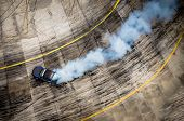 Top View Of Aerial From Drone. Professional Driver Drift Car On Asphalt Track.motor Sports Concept. poster