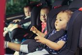 Three Children In Car Safety Seat - Family, Transport, Safety, Road Trip And People Concept poster