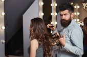 Hairdresser During Work With Beautiful Woman Client. Hairstylist Cutting Long Brunette Woman Hair In poster