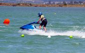 stock photo of waverunner  - A jetski racing between the markers in the sea  - JPG