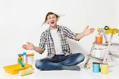 Fun Man In Newspaper Hat With Pencil Behind Ear Sitting On Floor With Instruments For Renovation Apa poster