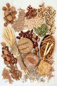 Food with high fiber content with whole grain bread rolls, whole wheat pasta, grains, nuts, seeds an poster