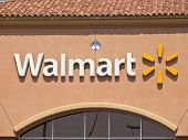 LOS ANGELES, CALIFORNIA, - SEPTEMBER 15:  Walmart reports a 0.9% quarterly sales drop in stores open
