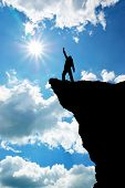 stock photo of mountain-climber  - Man on top of mountain - JPG