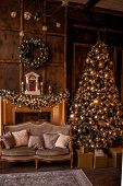 Christmas Background With Illuminated Fir Tree With Golden Decpration And Fireplace In Living Room. poster
