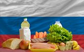 Basic Food Groceries In Front Of Russia National Flag
