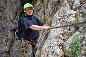 Young Man Climbing On Via Ferrata