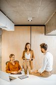 Office Employees Having Some Informal Conversation At The Workplace In The Office poster