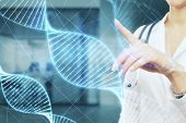 Medicine And Biochemistry Concept. Doctor With Stethoscope And Glowing Medical Dna Interface On Blur poster