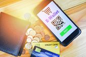E Wallet App On Smartphone With Credit Card And Coin In Wallet Technology Pay / Mobile Payment Onlin poster