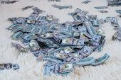 Many Banknotes Fly In The Air On A White Bed In Slow Motion. Huge Wealth Of Money, Slow Motion, Top  poster