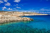Rocky Coast And Clear Sea Turquoise Water, Clear Blue Sky With Clouds. Cape Cavo-greco, Cyprus. poster