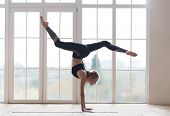 Young Sporty Flexible Woman Practicing Yoga, Doing Handstand Pose With Splitted Legs, Indoor Full Le poster
