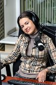Anchorwoman In Front Of A Microphone On The Radio