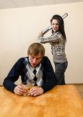 Domestic Violence: Wife Trying To Beat Her Husband With A Metal Rod poster