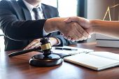 Handshake After Good Deal Negotiation Cooperation, Professional Male Lawyer Or Counselor And Client  poster