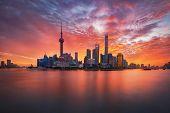 colorful sunrise over Lujiazui skyline and Huangpu river, Shanghai, China poster