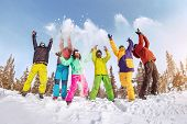 Group Of Happy Friends Skiers And Snowboarders Are Having Fun And Tossing Snow. Ski Resort Concept poster