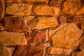 Stone Texture. Brown And Terracotta Rock Background. Surface Of The Rock. Close Up Of Rock Texture. poster