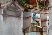Stone Bust In The Most Famous Cemetery Of Paris Pere Lachaise, France. Tombs Of Various Famous Peopl poster