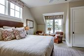 Beautiful upstairs bedroom with expensive furniture and view of a river. poster