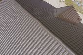 Modern Roof Made Of Metal. Brown Metal Tile On The Roof Of The House. Corrugated Metal Roof And Meta poster