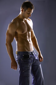 pic of male body anatomy  - Male torso without shirt in jeans.