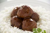 stock photo of chinese parsley  - Chinese meat balls in hoisin sauce on a bed of white rice with parsley - JPG