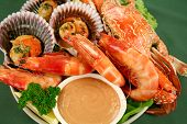 stock photo of scallops  - Fresh seafood platter of cooked shrimps sand crab and pan fried scallops with coriander with Thousand Island Dressing - JPG