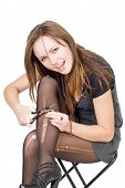 image of bitchy  - Girl with scissors cuts the stockings - JPG