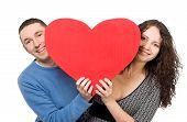Smiling Loving Couple Holding Heart