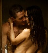 picture of enamored  - Loving couple engaged in love in a bath booth - JPG