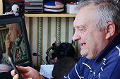 An Elderly Man And Phone