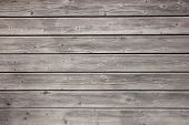 weathered grey boards of fencing