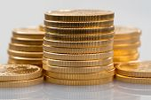 image of treasury  - Stacks of gold eagle one troy ounce golden coins from US Treasury mint - JPG