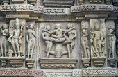 stock photo of kandariya mahadeva temple  - Erotic sculptures decorating the ancient Kandariya Mahadeva Hindu Temple at Khajuraho Uttar Pradesh India - JPG